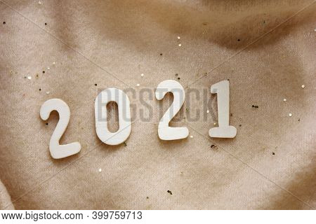 The 2021 New Year's Number Is Lined With Wooden Numbers On A Beige Fleece Blanket Sprinkled With Gol