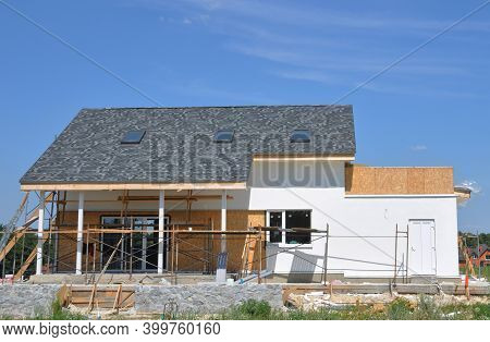 The House Facade And Patio Renovation. Painting, Rendering And Renovating The Exterior Walls Of A Ho
