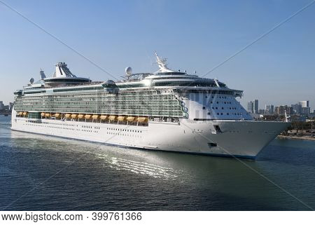 The Large Cruise Liner Leaving Miami Through The Main Channel (florida).