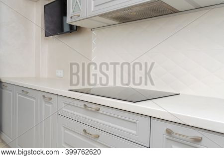Beautiful Classic Kitchen In Light Grey And White Tones With Induction Cooker