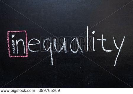 The Word Inequality On The Blackboard. Inequality,