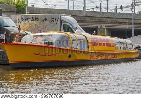 Amsterdam, Netherlands - May 17, 2018: Dhl Express Delivery Boat At Canal In Amsterdam, Holland.