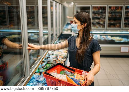 Young Woman With Protective Face Mask Shopping For Groceries In Indoor Groceries Store.coronavirus C