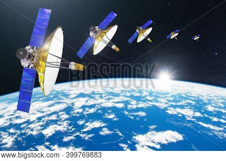 Group Of Satellites With Dish Antennas In Orbit Around The Earth, For Communication And Monitoring S