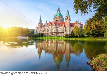 Hanover, Germany. Building Of New Town Hall Reflecting In Water On Sunset (hdr-image)