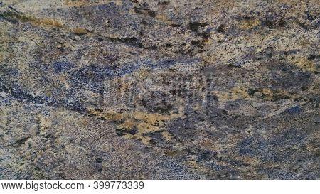 Natural Black Albena Granite Stone Texture Background. Black Albena Granite Surface For Interior And