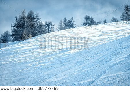 Mountain Ski Slope Background On The Skiing Resort. Active Winter Holiday. European Ski Resort In Al