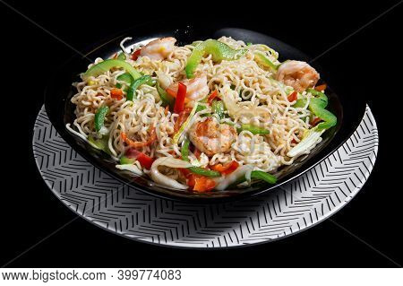 Japanese Noodles Called Yakisoba With Shrimp On A Black Plate