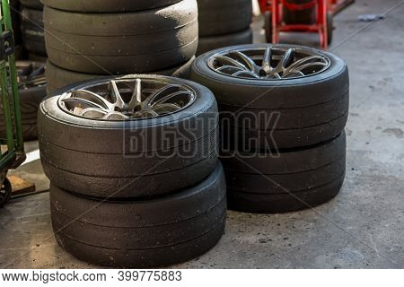Group Of New Tires For Race Car. New Tires For Sale At A Tire Store. Car Tires In The Warehouse.