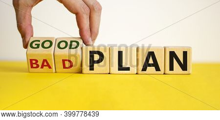 Good A Bad Plan Symbol. Male Hand Flips Wooden Cubes And Changes Words 'bad Plan' To 'good Plan'. Be