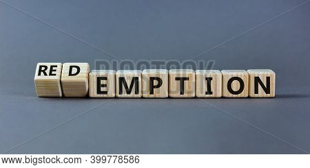 Redemption Or Emption Symbol. Fliped A Wooden Cube And Changed The Word 'emption ' To 'redemption'.