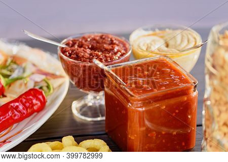 Hot Chili Pepper Sauce Paste Harissa Close Up. Healthy Spicy, Creamy Vegetarian Appetizer Or Snack W