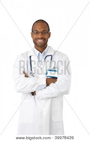 Happy afro doctor portrait, smiling with arms crossed, wearing stock, looking at camera, cutout on white.