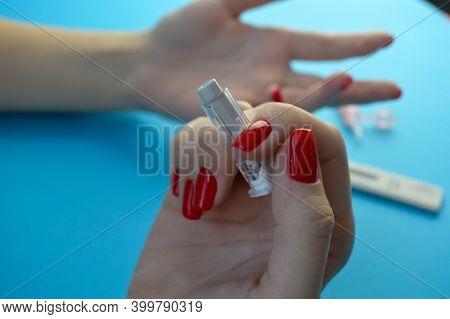 Coronavirus Covid-19 Quick Rapid Diagnostic Test Rdt, Medical Worker Place Collected Patient Finger