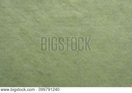 background and texture of a green paper made in Bhutan by tsharsho papermaking methods