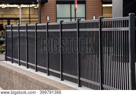 A Black Iron Fence Metal Steel Desing Style