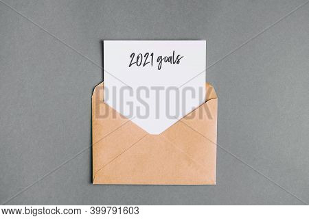 Envelopes With A White Letter Sheet On A Grey Background. Christmas Composition. White Paper With Go