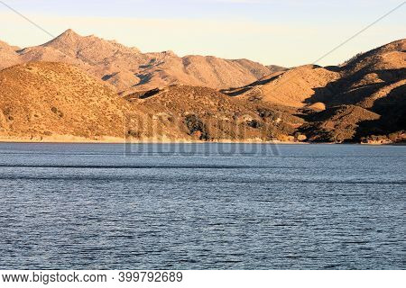 Barren Mountains Surrounding Silverwood Lake, Ca During Sunset Creating Natural Shadows Taken In The