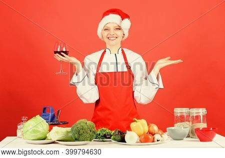 Woman Chef Cooking Christmas Dinner Wear Santa Hat. Best Christmas Recipes. Enjoy Easy Ideas For Hol