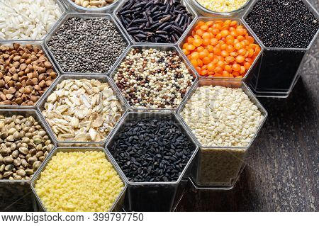 Food Background Of Various Cereals And Grains In The Hexagonal Honeycomb Jars