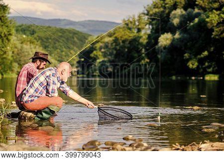 Fishing On The Lake. Fly Fish Hobby Of Men. Retirement Fishery. Happy Fishermen Friendship. Catching