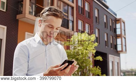 Young and attractive freelancer working outdoor. Office worker or businessperson. Business and social distancing.