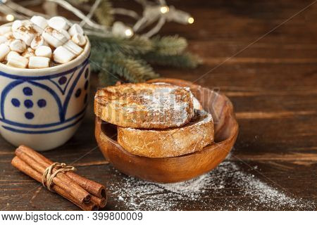 Croutons With Powdered Sugar And Cinnamon And Cocoa With Marshmallow Close-up. Christmas Tree And Ga
