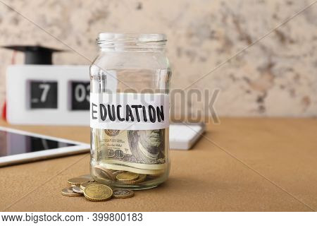 Jar With Money For Education On Table. Tuition Fees Concept