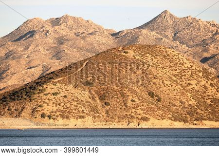 Barren Mountains Covered With Chaparral Plants On Arid Desert Terrain Surrounding Silverwood Lake, C