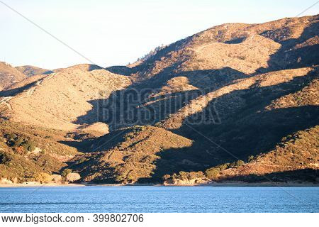 Rural Mountainous Terrain Covered With Grasslands During The Late Afternoon Sunlight Creating Natura