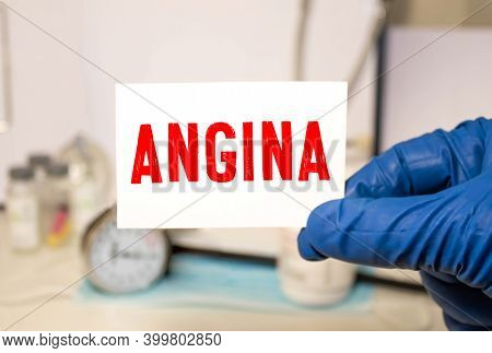 Angina Word Written On Medical Blue Folder With Patient Files, Pills And Stethoscope On Background.