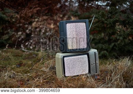 White noise and nothing on two analogue TV sets in outdoor environment