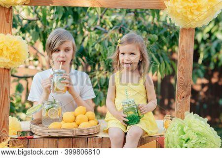 Children Drink Natural Lemonade At Stand In Park. Summer Refreshing Natural Drink Lemonade. Detox Fr