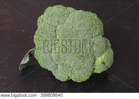 Broccoli Isolated On Black Background. Raw Broccoli Vegetable Close Up