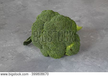 Broccoli Isolated On White Background. Raw Broccoli Vegetable Close Up