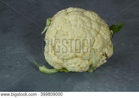 Raw Cauliflower, Whole Vegetable. Fresh Cauliflower Isolated On Stone Background.