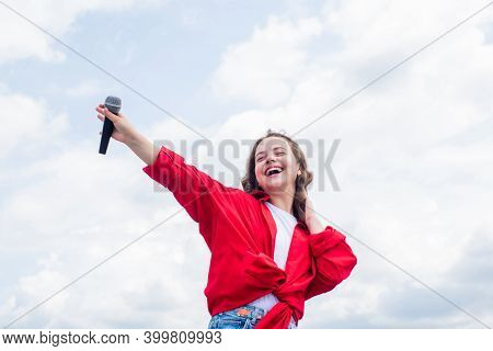 Music And Life. Teen Girl Singing Song With Microphone. Having A Party. Happy Kid With Microphone. S