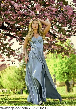 Spring Fashion Collection. Woman Fancy Dress Gown Spring Flower Sakura Bloom. Pretty Blonde Fancy Wo