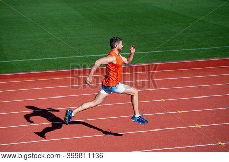 Sportsman Man In Sportswear Run Fast Sprinting On Running Track, Energy