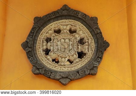 Carved Circle Window In Brahma Vihara Arama Buddhist Temple, Bali, Indonesia. Stone Carved Of Circul