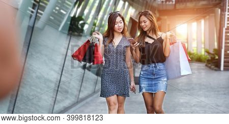 Women Holding Shopping Bags Outdoors Happy Woman With Shopping Bags Enjoying In Shopping. Consumeris