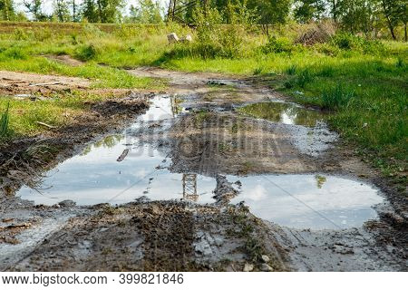 The Harsh Landscape Nature And Road Through The Fields For The Off-road Suv With Puddles And Mud. Au