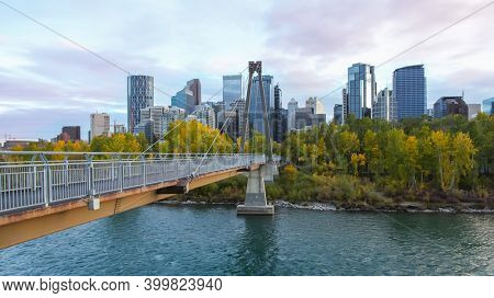 CALGARY, ALBERTA, CANADA - September 24 , 2017 - Bow river pathway  bridge connects Princes island park with Downtown Calgary