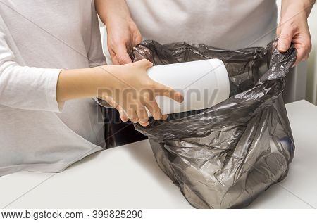 Mother And Kid Sorting Garbage. Waste Separate Collection And Recycling. Female And Child Hands Fold