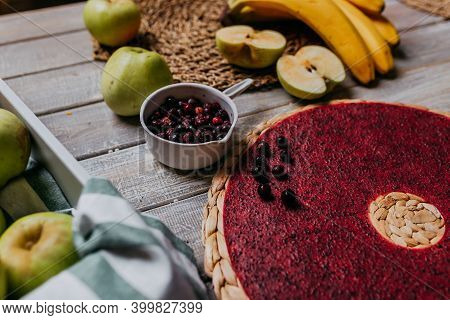 Black Currant Fruit Leather With Fresh Fruits On The Wooden Table. Round Red Fruit Leather With Blac