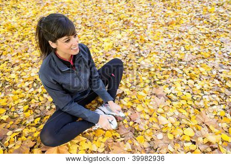 Girl Stretching Legs In Autumn