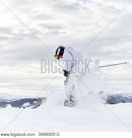 Concept Of Winter Kinds Of Sport. Skier Conducting Tricks In The Mountains In Winter Season, Merging