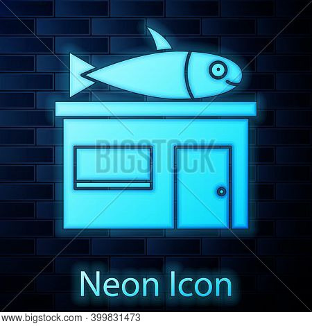 Glowing Neon Seafood Store Icon Isolated On Brick Wall Background. Facade Of Seafood Market. Vector.