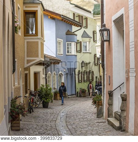 Brixen, Italy - October 5, 2020: Small Street In The City Of Brixen, Bressanone, With Yellow And Blu