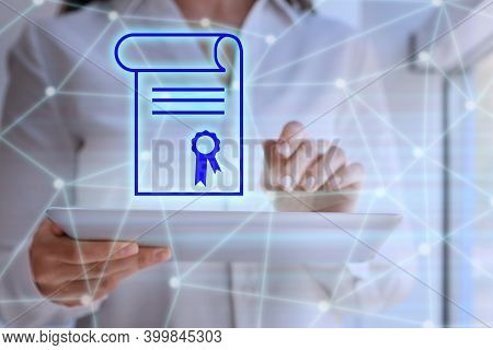 Online Learning Concept. Diploma Icon On Foreground And Woman Using Tablet, Closeup
